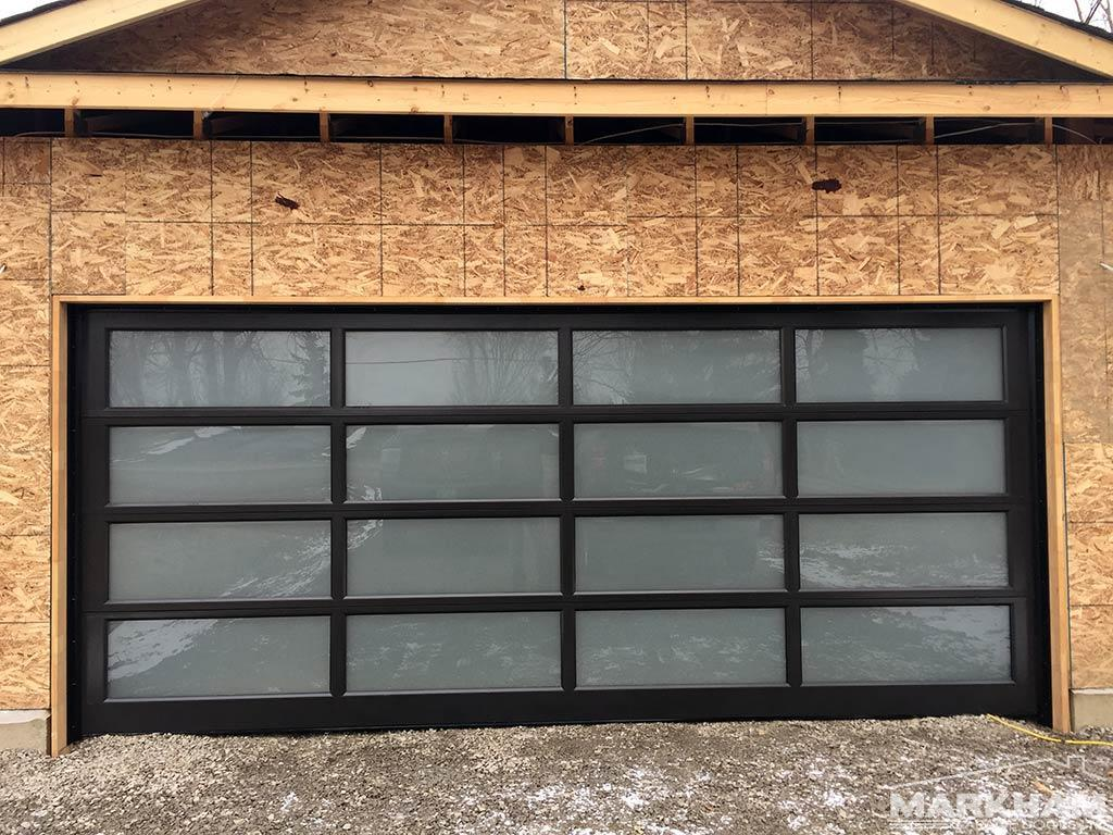 Full-view-aluminum-garage-door-dark-bronze-frosted-glass